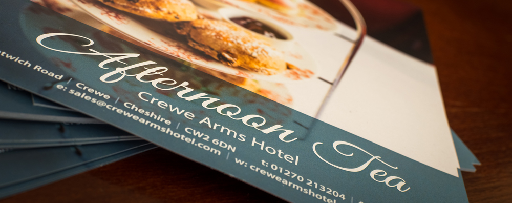 Macro shot of a pile of Afternoon Tea flyers for Crewe Arms Hotel