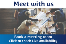 "Top-down view of a small business meeting around a conference table enclosed by copy that reads ""Meet with us Book a meeting room Click to check Live availability"""