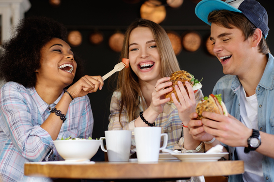 Student's eating and laughing together